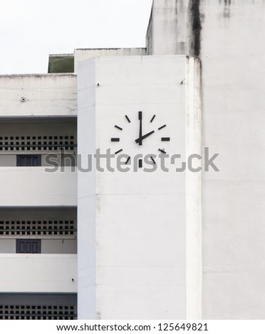 Old wall clock of the school building.