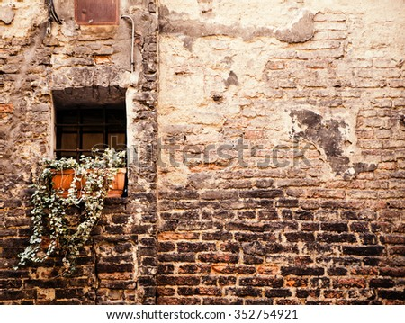 Old wall from the  stone and window with lattice - stock photo