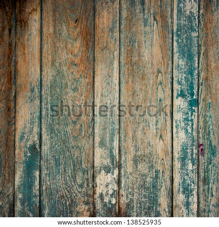 Old wall from wooden planks with paint traces - stock photo
