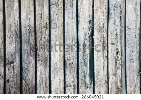 Old wall from wooden planks with paint traces. - stock photo