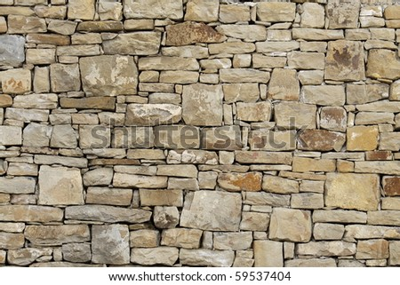 old wall in stones closeup - stock photo