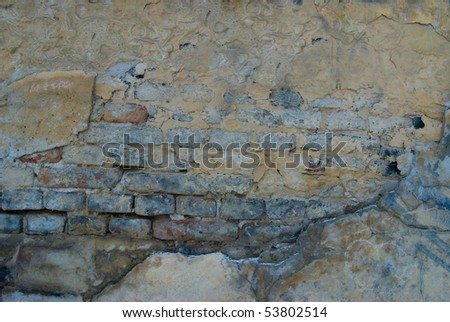 Old wall made from bricks and plaster pattern - stock photo