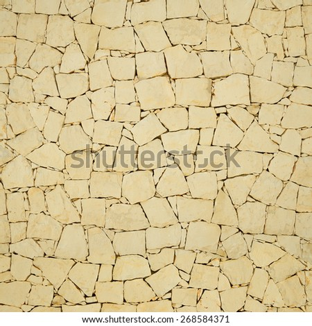Old wall made of natural stone - stock photo