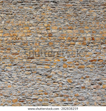 Old wall made of the Jerusalem sand stone - stock photo
