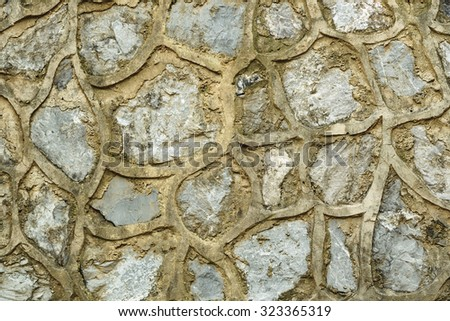 Old wall of brown granite stones texture for design, website, wallpaper, background