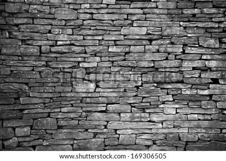 old wall of stone bricks textured background - stock photo