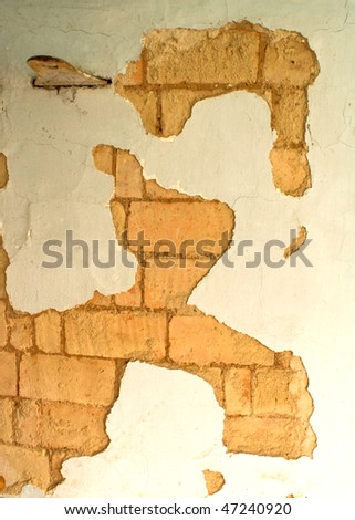 old wall of stove and collapsed stucco - stock photo