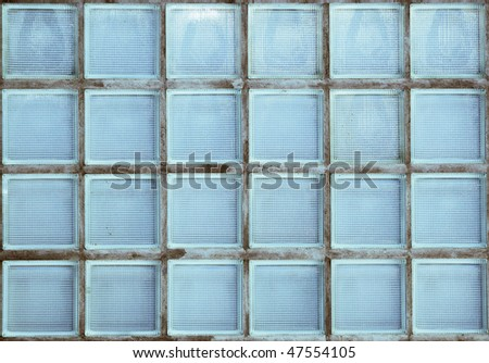 Old wall of translucent glass blocks - stock photo