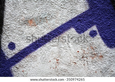 Old  wall painted blue purple black white paint.