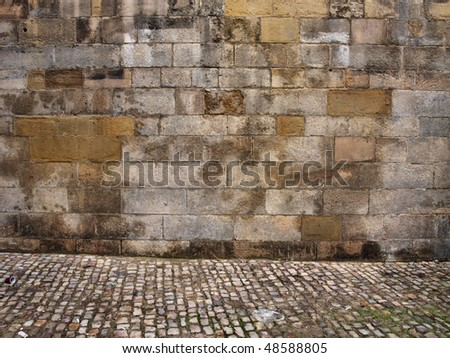 Old wall texture with cobblestone - stock photo