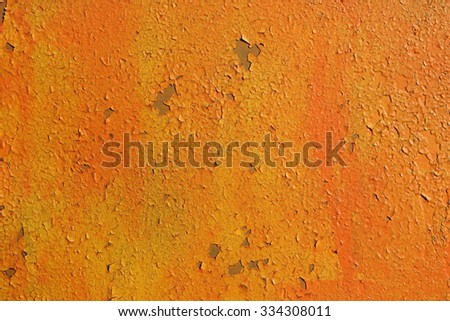 Old wall. The texture of the old shabby wall in orange tones. - stock photo