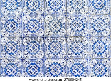 Old wall tiles azulejos. - stock photo