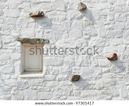 Old wall with a window with shattered. Background. Texture - stock photo