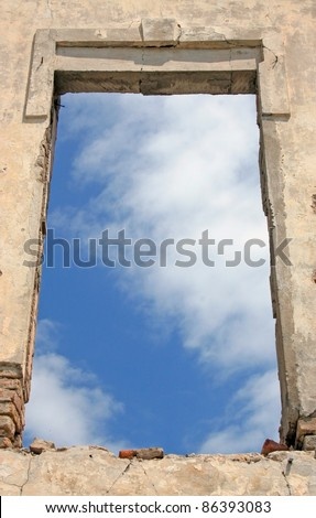 Old wall with sky through window - stock photo
