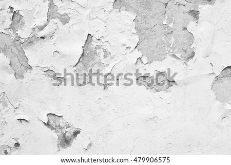 Old wall with white paint peeling off texture in black and white tone