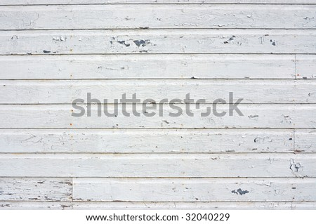 Old wall with white peeling siding - stock photo
