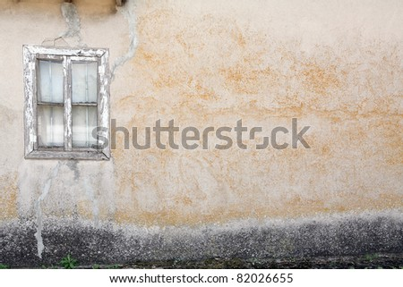 old wall with wooden window - stock photo