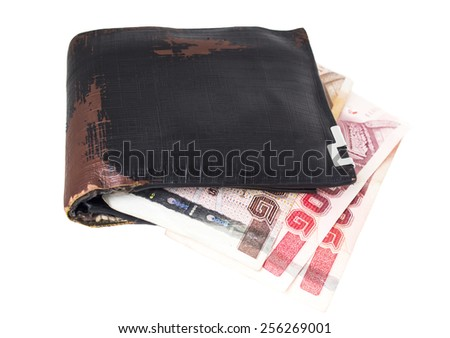 Old wallet and bank notes on white background. - stock photo