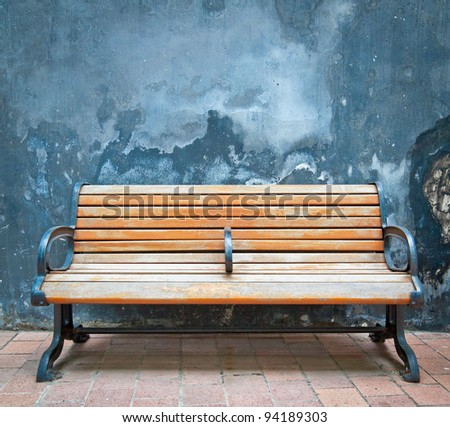 Old walls and old wooden chairs - stock photo
