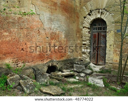 Old walls and the front door in an old abandoned house.