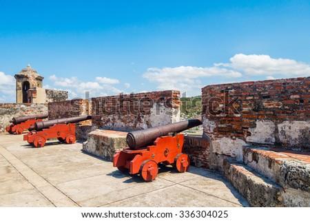 Old war cannon in Castillo San Felipe Barajas, impressive fortress located in Lazaro hill, Cartagena de Indias, Colombia - stock photo