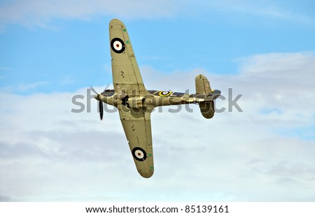 OLD WARDEN, UNITED KINGDOM - AUGUST 7: Hawker Sea Hurricane mid turn, underside view, during the Shuttleworth Collections summer air gala at Old Warden on August 7, 2011. - stock photo