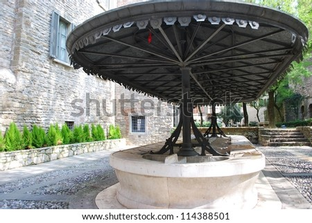 Old washing place in a small square, Bergamo, Lombardy, Italy - stock photo