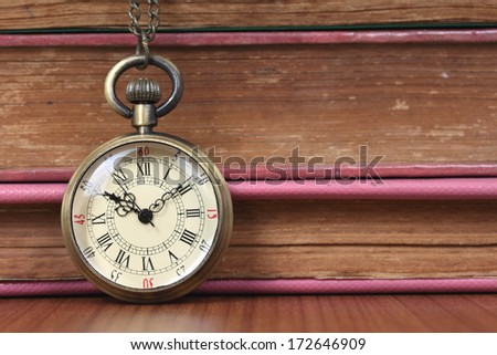 old watch and old book - stock photo