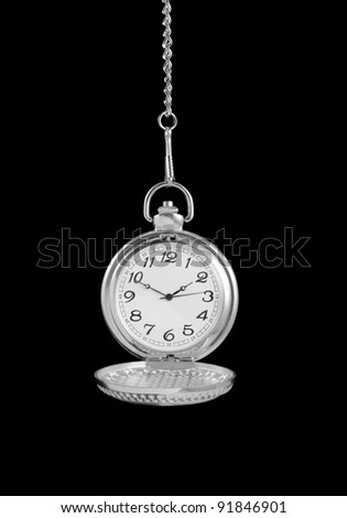 Old watch isolated on black background - stock photo