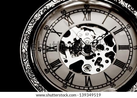 Old watch machine on black background - stock photo