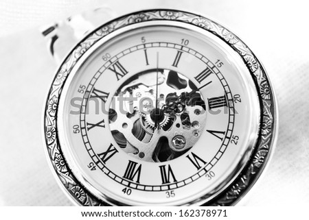 Old watch machine on white background
