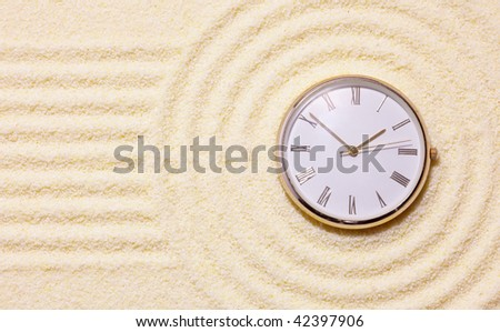 Old watch on sand in a composition of the Japanese rock-garden - stock photo