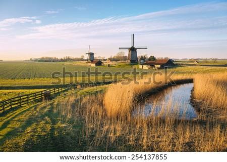 Old water mill beside Eilandspolder in evening light, the Netherlands - stock photo