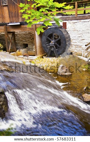 Old water saw mill with flowing water
