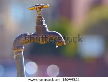 Old Water Tap in the Open and Water Drops - stock photo