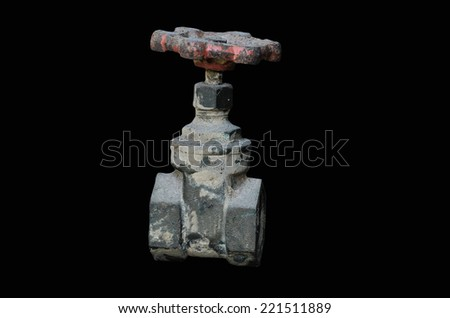 Old Water valve on black background - stock photo