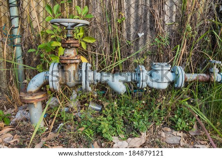Old Water valve opening - stock photo