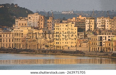 Old waterfront buildings in Havana at sunset - stock photo