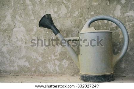 old watering can - stock photo