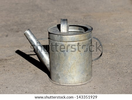 old watering can for watering, zinc
