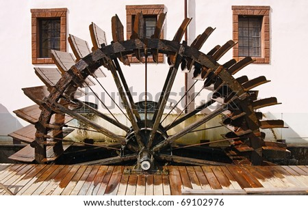 Old watermill on Chertovka river in  Prague. - stock photo