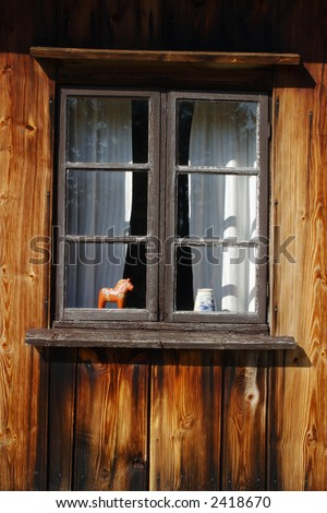Old weather beaten cottage window. - stock photo