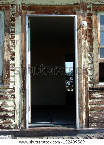 old weathered abandoned building door - stock photo