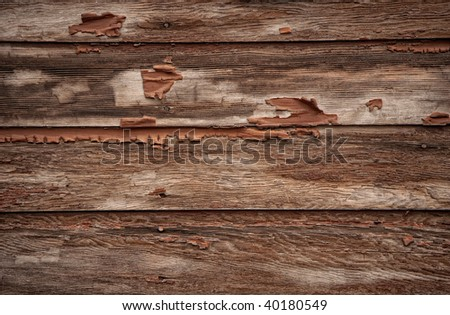 Old weathered barn boards with paint chipping away - stock photo