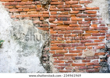 Old weathered brick wall fragment. - stock photo