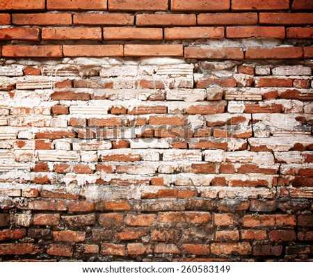 Old weathered brick wall fragment wall of brick. - stock photo