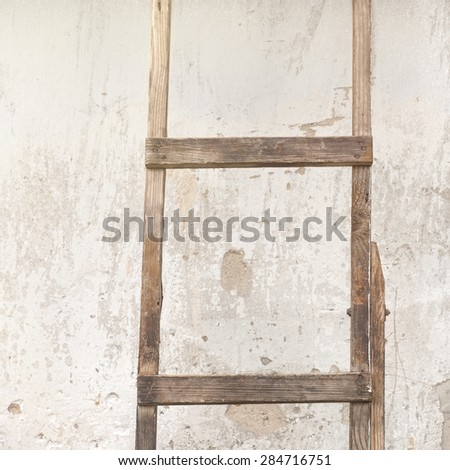 old, weathered brick wall, ladder near the wall background - stock photo