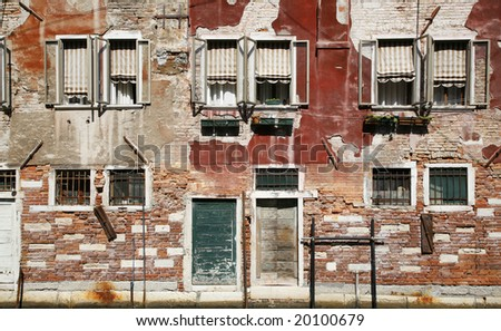 Old weathered building along a canal Venice, Italy