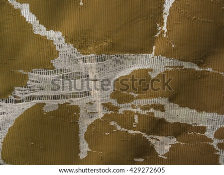 Old weathered cloth showing damage and decay caused by sun, wind, and rain Asia