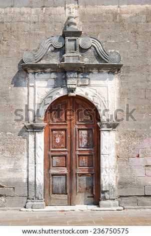 Old weathered door of a small greek church - stock photo